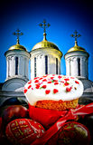 Easter  cake and  eggs on background of church Stock Photo