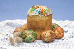 Easter cake and eggs on blue background Royalty Free Stock Image