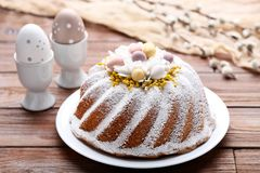 Easter cake with eggs. On brown wooden table royalty free stock image