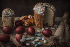 Easter cake with eggs and candy. Easter breakfast in low key against the dark background Royalty Free Stock Photo