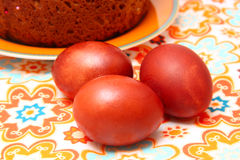 Easter cake and eggs. On colorful  tablecloth Royalty Free Stock Image