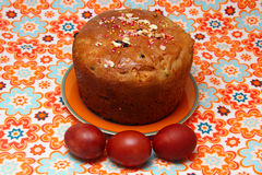 Easter cake and eggs. On colorful  tablecloth Stock Images