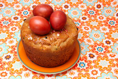 Easter cake and eggs. On colorful  tablecloth Royalty Free Stock Images