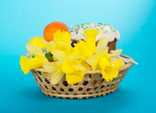 Easter cake, eggs and flowers in basket Stock Photo