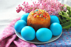 Easter cake and eggs. On a plate royalty free stock photography
