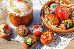 Easter cake and eggs. Easter cake with red candle and eggs on wooden table Stock Photo