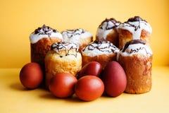 Easter cake eggs still life. Christianity holiday religion brunch, homemade baked dessert on yellow background. Easter cake eggs still life. Christianity stock image