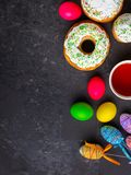 Easter cake and Easter eggs, traditional holiday attributes Happy Easter!. food background. top view royalty free stock photo