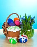 Easter cake and eggs, vase with the flowers stock photo