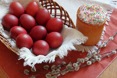 Easter cake, eggs in a wicker basket Royalty Free Stock Image