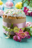 Easter cake, flowers and eggs on a turquoise table Stock Photos