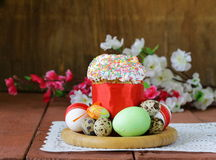 Easter cake with glace icing and colored easter eggs Stock Photo