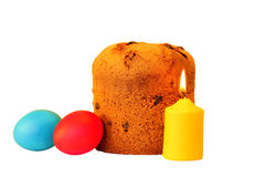 Easter cake, holiday multicolored eggs and a burning candle Stock Photos