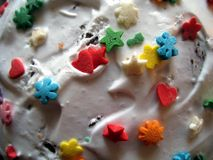 Easter cake icing with colored candy Stock Photography