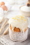Easter cake, kulich with glaze, eggs. Traditional Russian pastry. Royalty Free Stock Photography