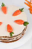 Easter cake with little carrots on white dish Stock Images