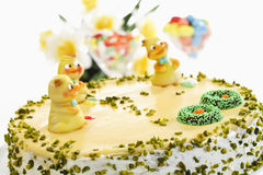 Easter cake, Marzipan cake with pistachio and chick figurines Royalty Free Stock Image