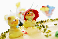 Easter cake, Marzipan cake with pistachio and chick figurines Stock Photos