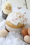 Easter cake and painted eggs on wooden table Royalty Free Stock Photos
