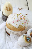 Easter cake and painted eggs on wooden table Royalty Free Stock Photography