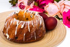 Easter cake and painted red eggs stock image