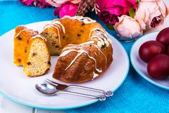 Easter cake and painted red eggs stock images