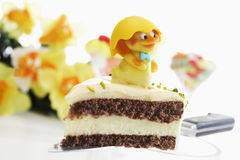 Easter cake, piece of marzipan cake with pistachio and chick figurine Royalty Free Stock Photos
