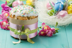 Easter cake, pink flowers and painted eggs Stock Image
