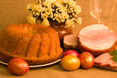 Easter cake and pork loin dish with easter eggs Stock Photos