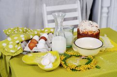 Easter cake products on the green table with flowers stock image