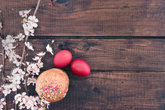 Easter cake and red eggs on rustic wooden table. Top view Stock Image
