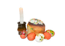 Easter cake, several different Easter eggs and burning candle Royalty Free Stock Photo