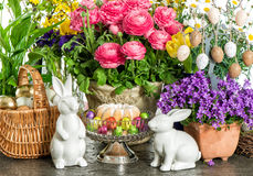 Easter cake, spring flowers, eggs and bunnies Stock Photo