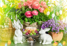 Easter cake, spring flowers, eggs and bunny. Light leaks Royalty Free Stock Photos
