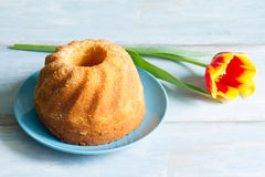 Easter cake and spring tulips Stock Photography