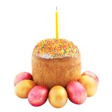 Easter cake with sugar glaze, painted eggs and candle isolated o Royalty Free Stock Photos