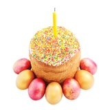 Easter cake with sugar glaze, painted eggs and candle isolated o Stock Photo