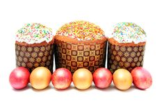 Easter cake with sugar glaze and painted eggs isolated on white Stock Image