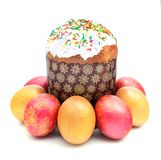 Easter cake with sugar glaze and painted eggs isolated on white Stock Photography