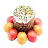 Easter cake with sugar glaze and painted eggs isolated on white Stock Images