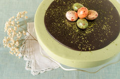 Easter cake with tea match decorated chocolate ganache and sweet-stuff eggs Royalty Free Stock Images