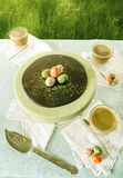 Easter cake with tea matcha decorated chocolate ganache and sweet-stuff eggs. Near cup of coffee. From series elegant desserts Stock Photos