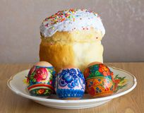 Easter cake and three eggs Stock Photos