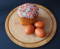 An easter cake with eggs on the wooden board stock photography