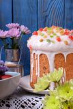 Easter cake topped with sugar glazing. And different pieces of candied fruits royalty free stock images
