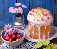Easter cake topped with sugar glazing. And different pieces of candied fruits stock photos