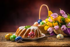 Easter Cake. Traditional ring marble cake with easter decoration. Easter eggs and spring tulips Royalty Free Stock Photography