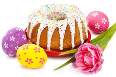 Easter cake, tulip and colorful eggs Stock Photo