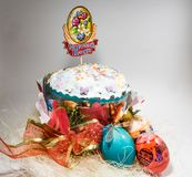Easter cake on white background with own hands royalty free stock photo