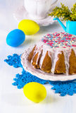 Easter cake with white glaze and a dragee Stock Photos